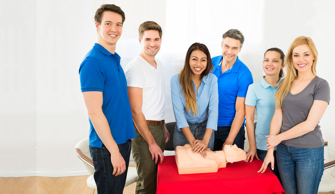 Group of people learning how to perform cpr
