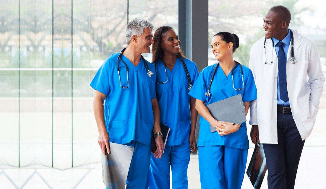 Group of successful medical doctors walking in hospital