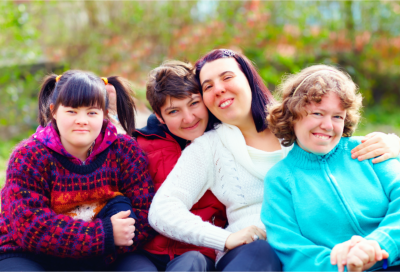 Caregiver Smiling with the group of disabled people